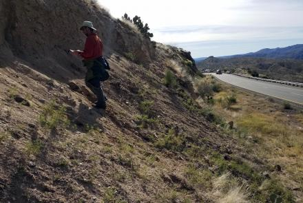 B. Gootee examining landslide deposits near Sunset Point.