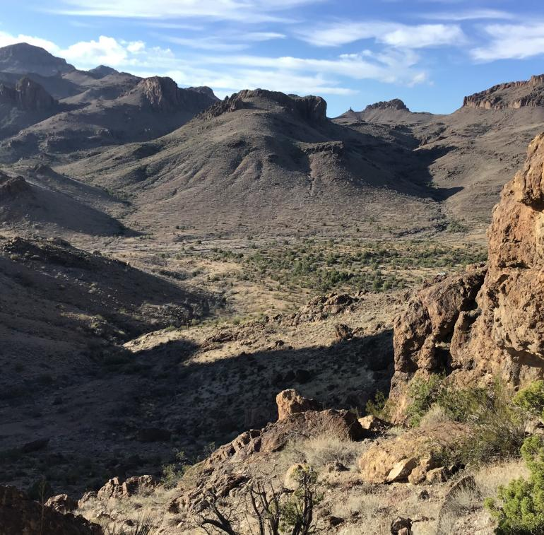 Looking southwest, across Secret Pass Wash towards the junction of the Secret Pass, Union Pass (west), Mt Nutt (south), and Oatman (southwest) 7.5' quadrangles.  The ridge is composed of 18-19Ma  andesitic and dacitic lavas at the base of the Miocene volcanic section.
